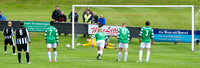 Buckie keeper Kevin Main saving penalty by Wick's Gary Weir