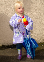Thurso Gala Strong man - decorated Umbrella and wellie boots 17/