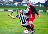 Wick Academy 2 v Inverurie 2  SHFL 23/11/2013<br/>Wick's Michael Steven clears the ball from the toe of Inverurie's Martin Bavidge