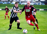 Wick 2 v Inverurie 2  SHFL 23/11/2013<br/>Inverurie's Martin Bavidge trying to get around Wick's Michael Steven