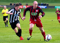 Wick Academy 2 v Inverurie 2  SHFL 23/11/2013<br/>Inverurie's Matin Bavidge being closely watched by Wick's Grant Steven