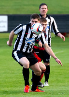 Wick Academy 2 v Inverurie 2  SHFL 23/11/2013<br/>Wick's Grant Steven checks out his next move under pressure from Inverurie's Andrew Hunter