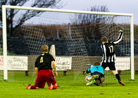 Wick 2 v Inverurie 2  SHFL 23/11/2013<br/>Inverurie keeper dives desparingly at Ross Allan's feet as the Wick man beats him to the ball  and steers the ball into the back of the net for Wick's second